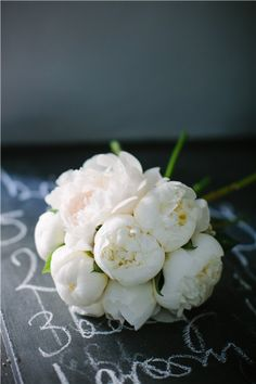 Beautiful bouquet: the bridesmaids    This fabulously full bouquet contained just one flower: Duchesse de Nemours peonies. The classic bloom is known for its ivory petals and lily of the valley-like scent.