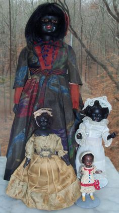 """Some of my favorite dolls in antique doll cabinets, 3"""" to 14"""" tall. So happy to find a dollhouse size 19th century beautiful black woman doll in silk ballgown! Both she and little girl in white have beautiful blue eyes.  Christy"""