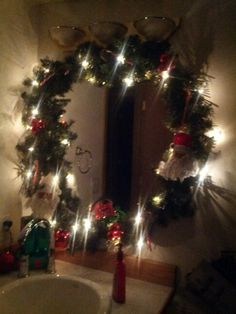 Framed my mirror with lit garland and decorations.