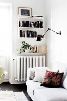 Sneaky Small Space Solutions Make use of the space above your radiator with wall mounted shelves.Make use of the space above your radiator with wall mounted shelves. Small Living Rooms, Home Living Room, Apartment Living, Living Spaces, Apartment Therapy, Living Area, Tiny Living, Apartment Ideas, Decoration Inspiration