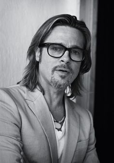 Brad Pitt, male actor, celeb, long hair style, glasses, powerful face, intense eyes, sexy, hot, portrait, photo b/w.