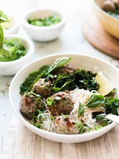 Thai-style Meatballs with Rice Noodles is a meatball and noodle dish the whole family will love! Beef meatballs simmered in a Thai-style coconut curry broth and served with bright green kale, aromatic herbs and rice noodles is simple enough for busy weeknights. This post is brought to you by Beef. It's What's For Dinner