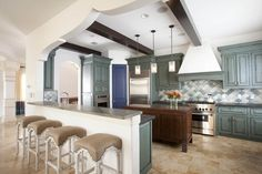 Laura U - Interior Designer - Houston - Moroccan - Kitchen - Blue - White - Tiled Floor - Neutrals - Arches - Dangling Light - Geometric - Cabinets - Bar - Leather - Bar Stools - Blue - White - Sleek