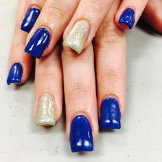 Gold and blue nails at Oliver Finley Academy of Cosmetology.