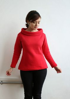 Note funnel neck (allow extra for turn on thick fabric), tapered sleeves, bright color, and very curvy sides. Straight sides on the dress version is far less feminine. Nice in sweatshirt knit.
