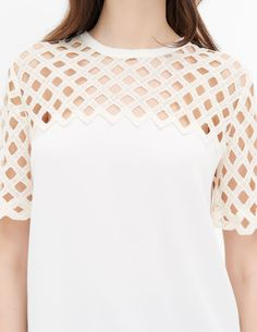 Short-sleeved Sandro top with a round neck. Top of the garment in lace, which is…