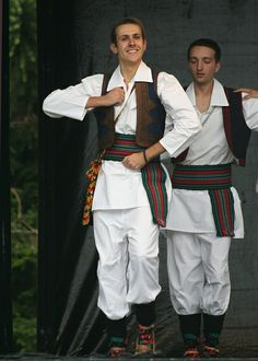 An image of the Serb men in their traditional costumes