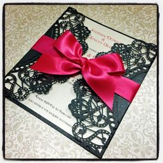 red and black wedding invites black lace paper with red ribbon- very pretty, can use different color combinations. Not just for weddings!