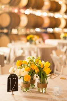 Yellow Flower Centerpieces by Brandon Wong Photography (http://www.brandonwongphotography.com)
