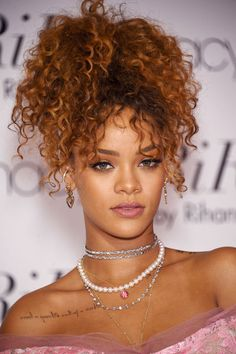 Rihanna can pull off the curly pony- and we're obsessed! Who else is on our list of favorite celebrity curly haired beauties? Find out here:
