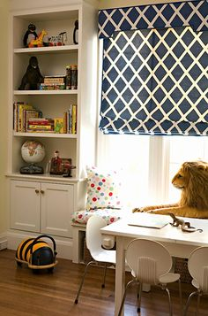Love the built in bookshelf and window seat