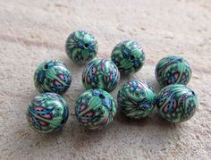 super fancy polymer clay petal cane beads. $20.25, via Etsy.