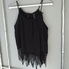 black sheer tank with flowy detail bottom Gorgeous black sheer black tank top. Absolutely gorgeous. Keyhole opening in the back. Beautiful lacy detail on the bottom. Very flowy and sexy. Size large but fits small medium or large . Tie top to adjust all around! Forever 21 Tops