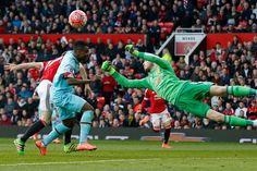 David De Gea punches clear of Emmanuel Emenike