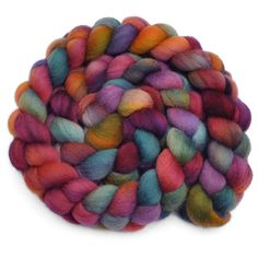 This wool is so amazing. I highly recommend Edgewood Garden Shop on Etsy. Hand dyed roving - EMBROIDERED ROBES - Falkland wool spinning fiber