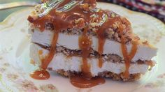 A graham cracker crust is topped with layers of sweetened cream cheese and a pecan oat crumble and snaked throughout with caramel sauce.  Frozen and served cold.