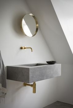 Contemporary bathroom in grey stone and brass by Norm Architects | DPAGES