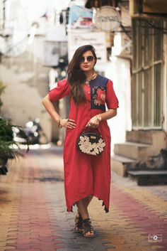 This cotton dress has two zardozi elephant motifs on its double pockets. It& perfect for a lunch date or evening party Kurti Patterns, Dress Patterns, Indian Attire, Indian Wear, Kurta Designs, Blouse Designs, Indian Designer Wear, Cotton Dresses, Designer Dresses