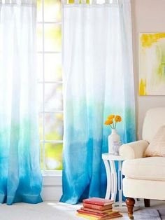 Make water color curtains according to any color pallet by coloring each section you want to dye with various sharpie colors and then spray  with 2% rubbing alcohol .