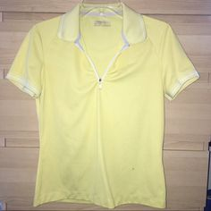 Pre-love NIKE Golf polo shirt Pre-loved Nike golf polo shirt size M.  There're 2 tiny stains by the left bottom side of the shirt (see enlargement in 4th pic).  Overall, still in great condition. Nike Tops Blouses