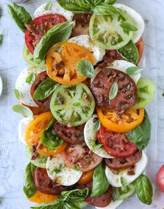 This Caprese Salad with Heirloom Tomatoes is is filled with fresh mozzarella, fresh basil and topped with a hot bacon dressing!