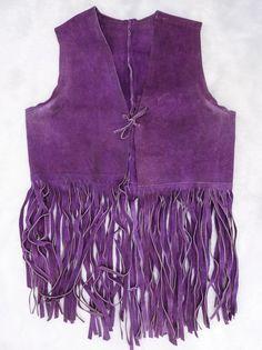 a short vest with long fringe