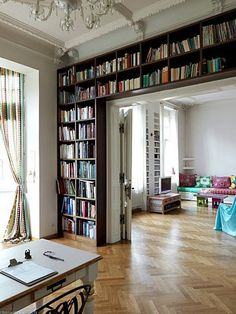 I hope I read this many books in my life time so I can do this in my den.
