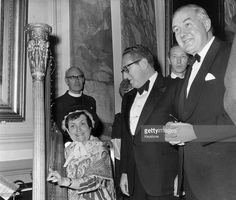 The American Secretary of State, Dr Henry Kissinger (centre) with British foreign secretary, James Callaghan (right) and a Welsh harpist at a reception in Cardiff City Hall.