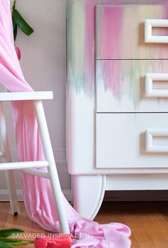 I used four (4) beautiful colors along with a blending and layering paint technique to create this gorgeous spring rainbow cabinet! It's another one of those pieces that got a whole lot ugly before it looked good, but I L-O-V-E the end result!