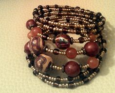 """Hand-made bracelet """"Autumn colors"""". A combination of hand-made beads and glass beads on memory wire."""