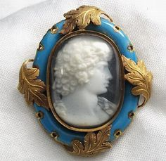 """""""Autinous Vertumnus""""-Material: Hard stone, 18 K gold tested, enamel.   Size: 1 5/8"""" by 1 3/8"""". Only cameo is 1"""" by 1 5/8"""".   Date and Origin: Circa 1876 Italy, frame is English. There is an engraved script on the back who reads """"In Memoriam E.F.S. In Pace Dec. 4th 1876""""   Conditions: Mint, just a bit of dust under the glass which covers the cameo."""
