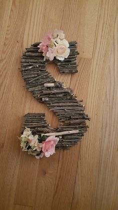 DIY Stick letter for baby girl nursery. Easily used for baby boy just don't add flowers