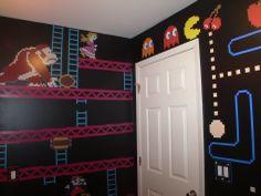 Donkey Kong and Pac-Man themed bathroom walls.
