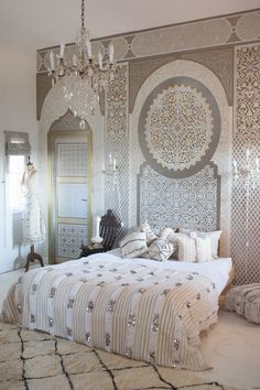 Bedroom at Peacock Pavilions in Marrakech Morocco.  Moroccan wedding blanket and carpet from the Souk by M.Montague