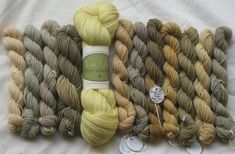 Wild Crafted Yarns dyed with horsetail, eucalyptus, plum leaves, and Queen Anne's Lace.
