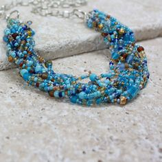Turquoise Brown and Golden Seed Bead by carolinascreations on Etsy, $10.00