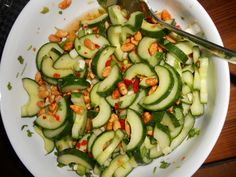 Beautiful Asien-inspired salad with cucumbers and peanuts.