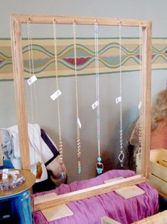 Craft show display. Long necklace display using a frame. Siren Nation 2015. Portland, OR