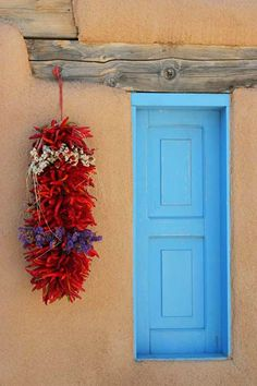 The ubiquitous blue doors and windows in Santa Fe, NM help keep away evil spirits ... Or, are painted so to honor Our Lady of Guadalupe. Either way, they're awesome!