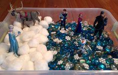 Winter Sensory Bin - Disney's Frozen Sensory Bin - it contains blue and clear gems (ice), cotton balls (snow), snowflake buttons and a Frozen playset - Preschool Sensory Activity