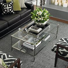 A bit over my budget (more than a bit), BUT I have seen this in person twice and LOVED it.   Maybe worth the splurge.  What do you think? Rectangular Cocktail Table