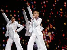 """Madonna and her dancers, dressed in Disco inspired outfits performing """"Music"""" during the Confessions Tour. Madonna Songs, Madonna Tour, Madonna Photos, Material Girls, Little Sisters, Live Music, Confessions, Tours, Inspired Outfits"""
