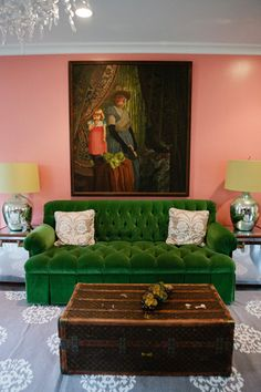 LOVE this green sofa against this pale pink wall