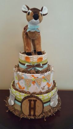 Woodland theme diaper cake, baby boy, baby shower centerpiece. Check out my Facebook page Simply Showers for more pics and orders.  https://m.facebook.com/adorablegifts