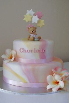 """""""Frangipani Christening Cake - This is another adaptation of the marbled christening cakes I have done. It was a pink, yellow and white, frangipani themed christening, so this is what I came up with. The flowers are artificial and the bear is ceramic. Cupcakes, Cupcake Cakes, Beautiful Cakes, Amazing Cakes, Baby Christening Cakes, Teddy Bear Cakes, Girl Cakes, Baby Cakes, Wilton Cake Decorating"""