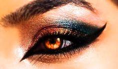 Fantastic eye makeup for winged, cat like, eyes, golden-ish…