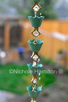 18 Creative DIY Rain Chains That You Can Make For Your Garden. I wonder what I have around the house to make some.