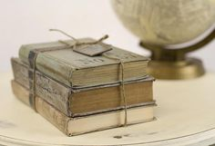 Vintage Book Decor -- Revive old books with damaged covers and paint with Chalky Finish for decor.