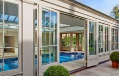 Explore Westbury Garden Rooms' case studies: glass garden rooms through to wooden orangeries, conservatories, pool houses and kitchen extension projects. Cool Pools, Awesome Pools, Westbury Gardens, Glass Pool, Outdoor Spaces, Outdoor Decor, Glass Garden, Painted Doors, Pool Houses