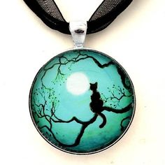 Black Cat Silhouette in Teal Handmade Jewelry Fine Art Pendant, http://www.amazon.com/dp/B007SYBBNQ/ref=cm_sw_r_pi_awdm_usJXsb1FP4V2E